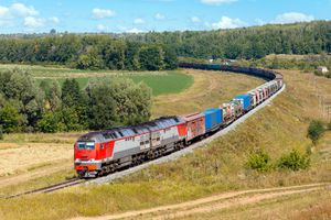 A long freight train in the country side.