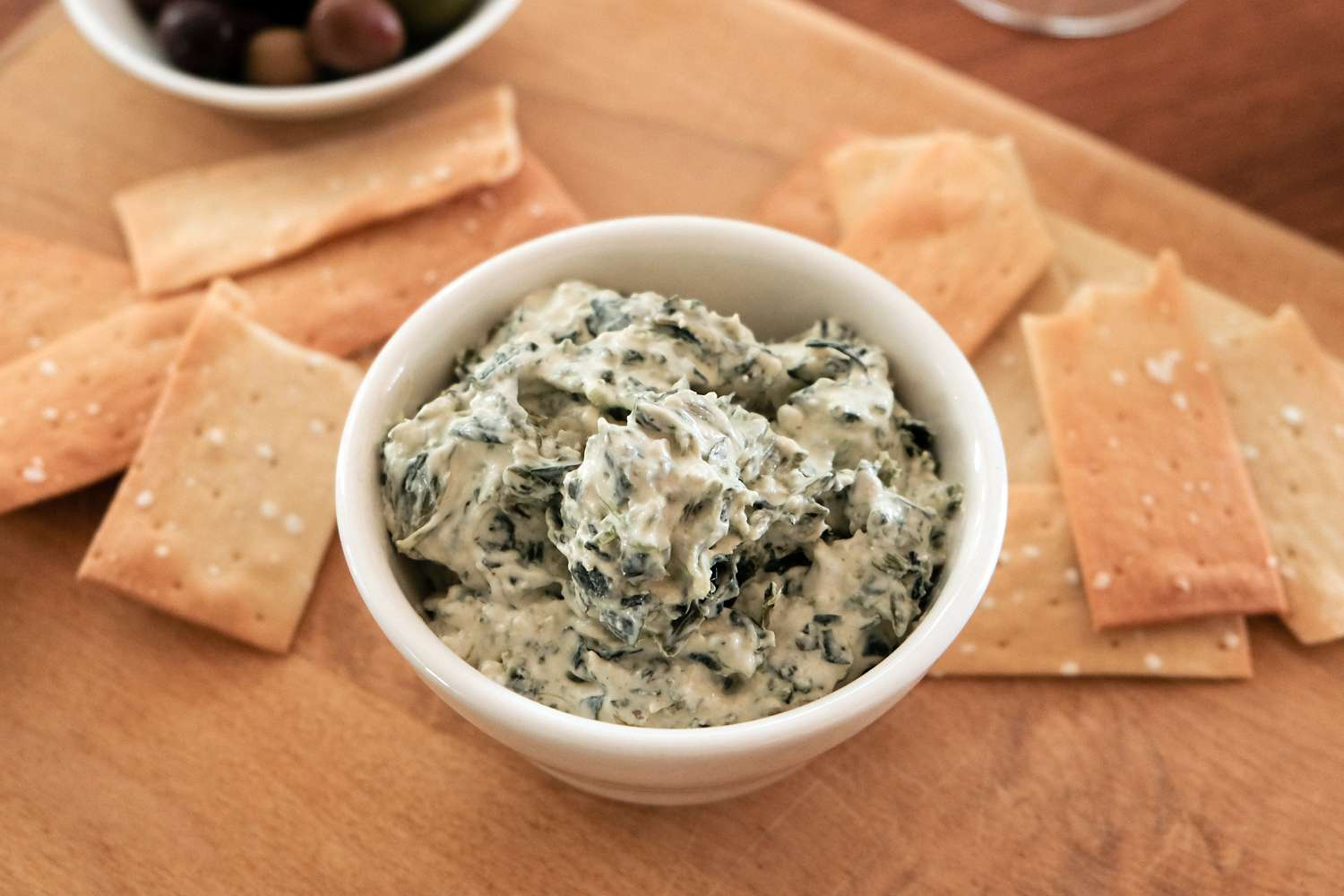creamy spinach with crackers on board