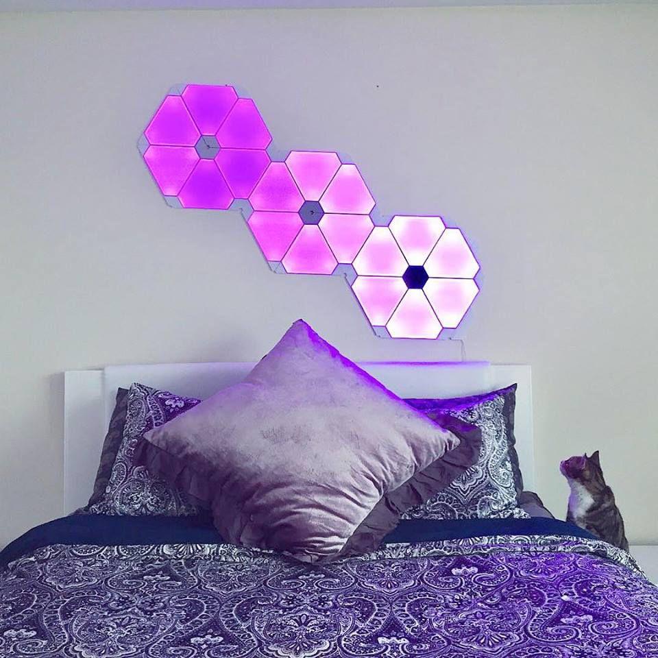 Nanoleaf lights panels over bed