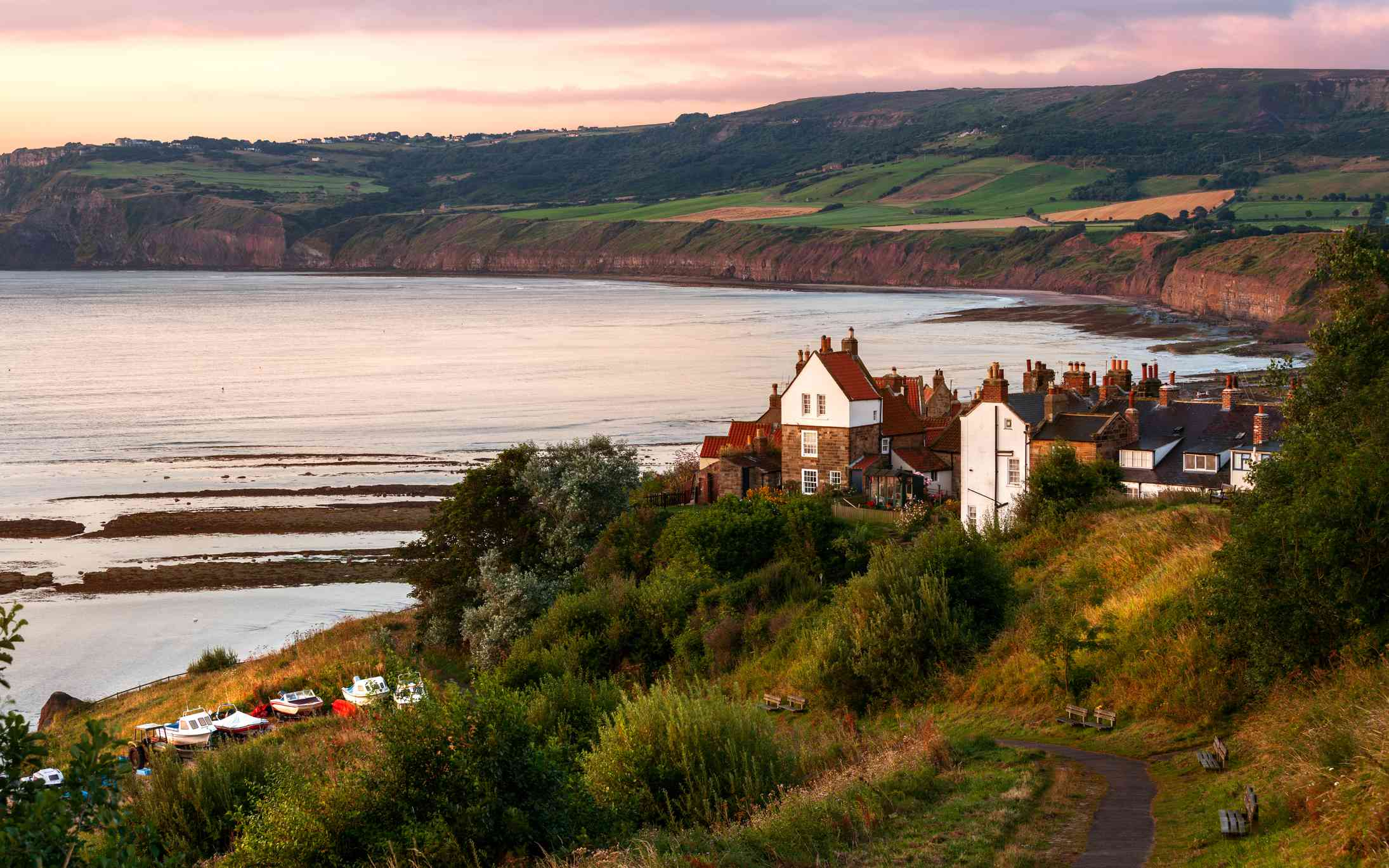 A narrow pathway leads down to a coastal town in Yorkshire