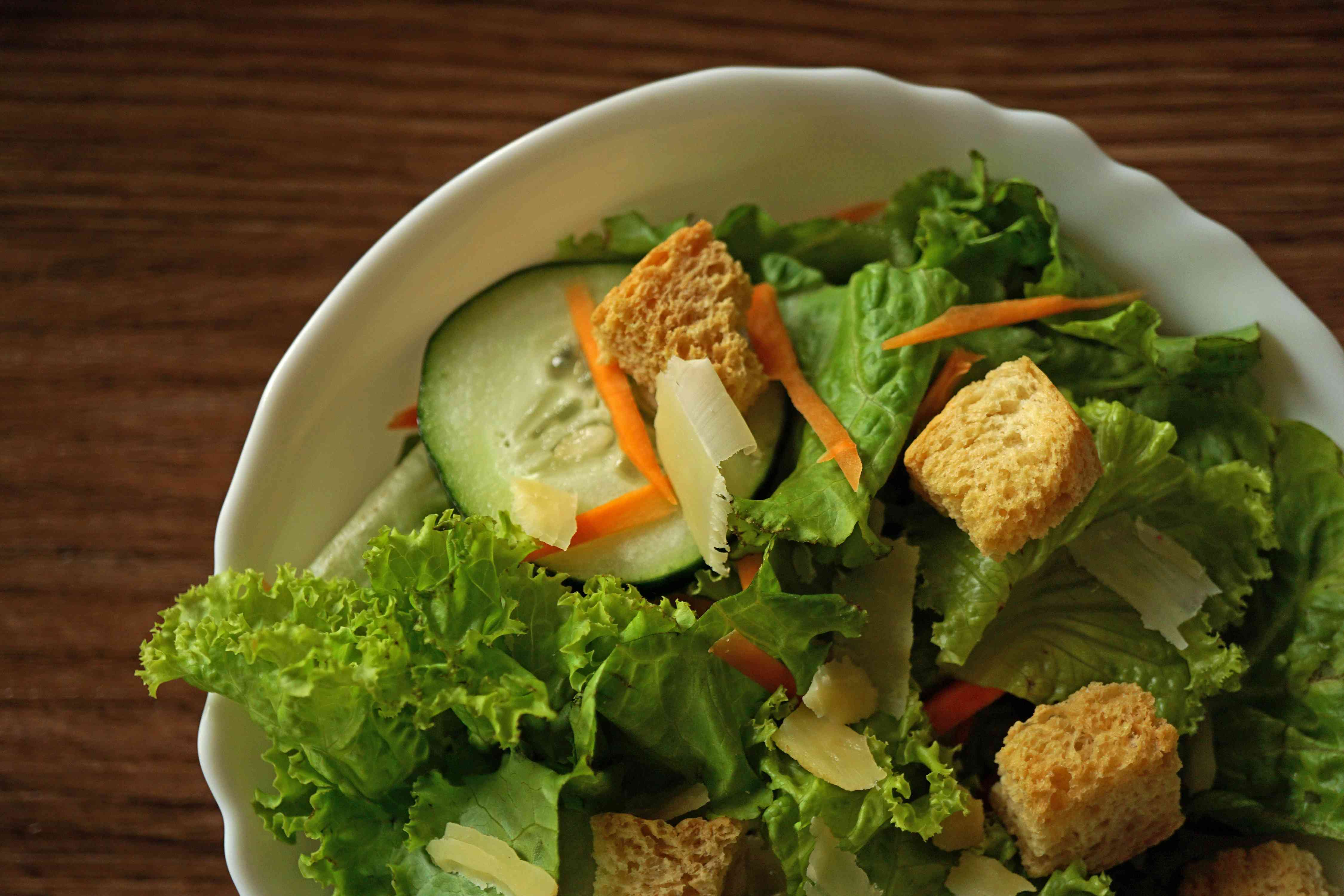 salad greens in bowl with croutons