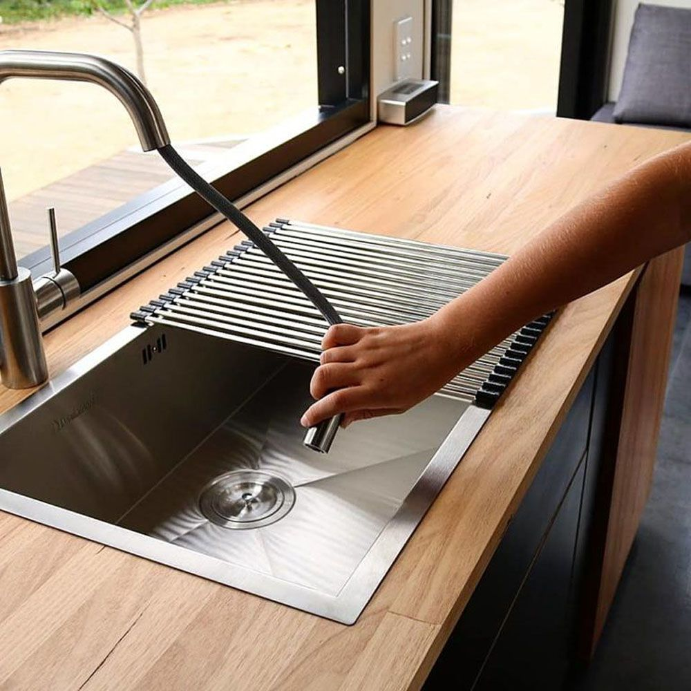 Close-up of sink with flexible hose