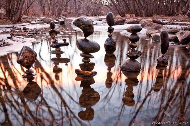 Stone balancing in creek during sunset