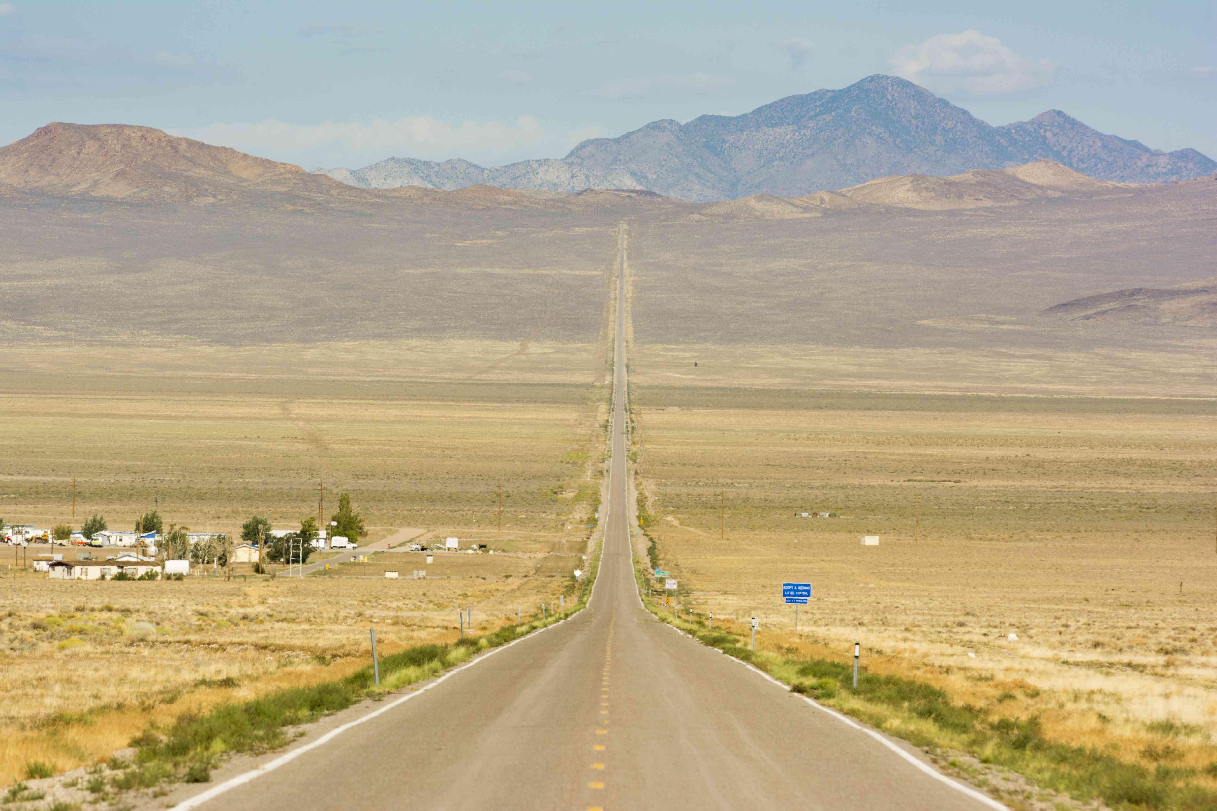 Route 50 cutting a path through the desert, toward mountains