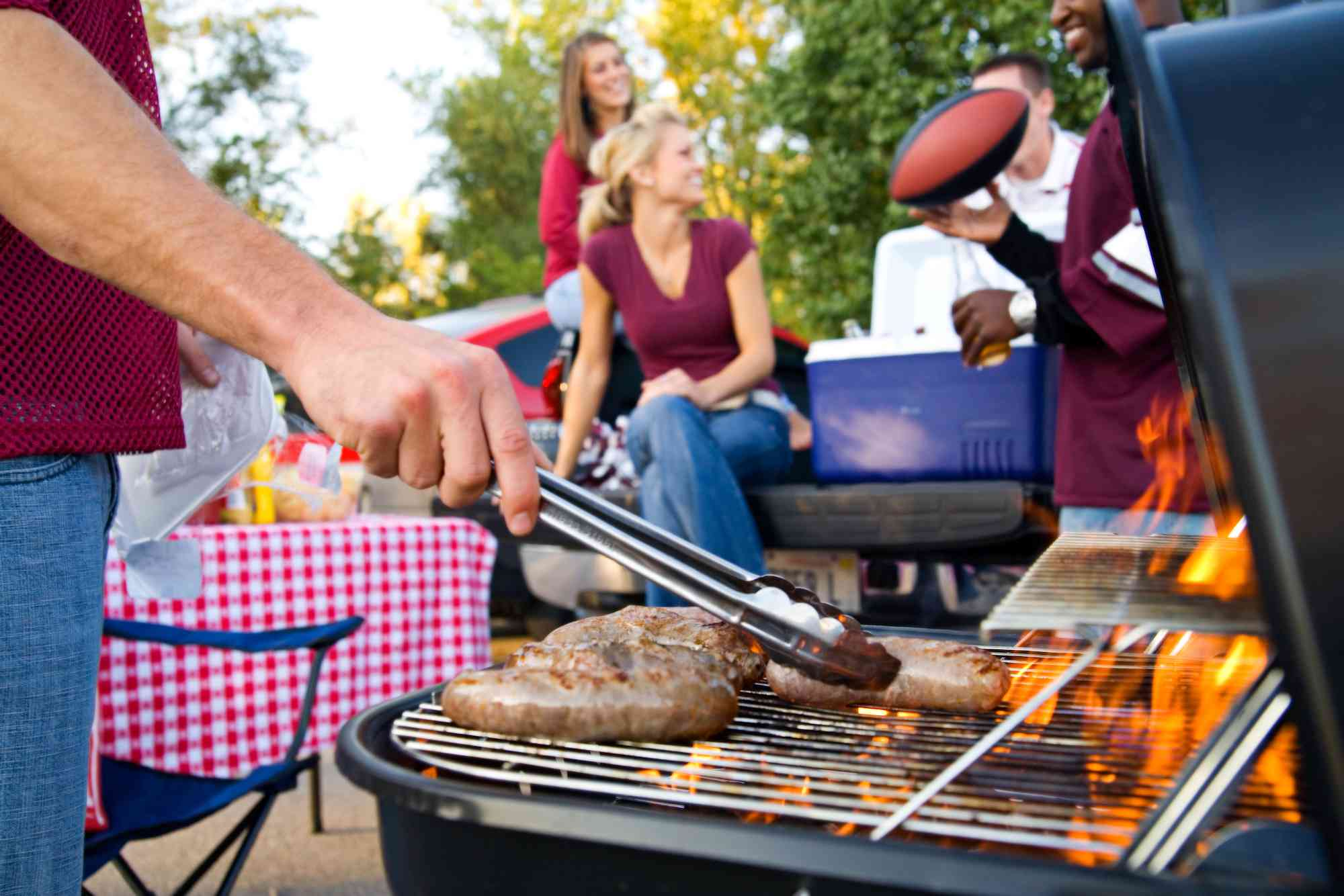 family tailgating grilling food