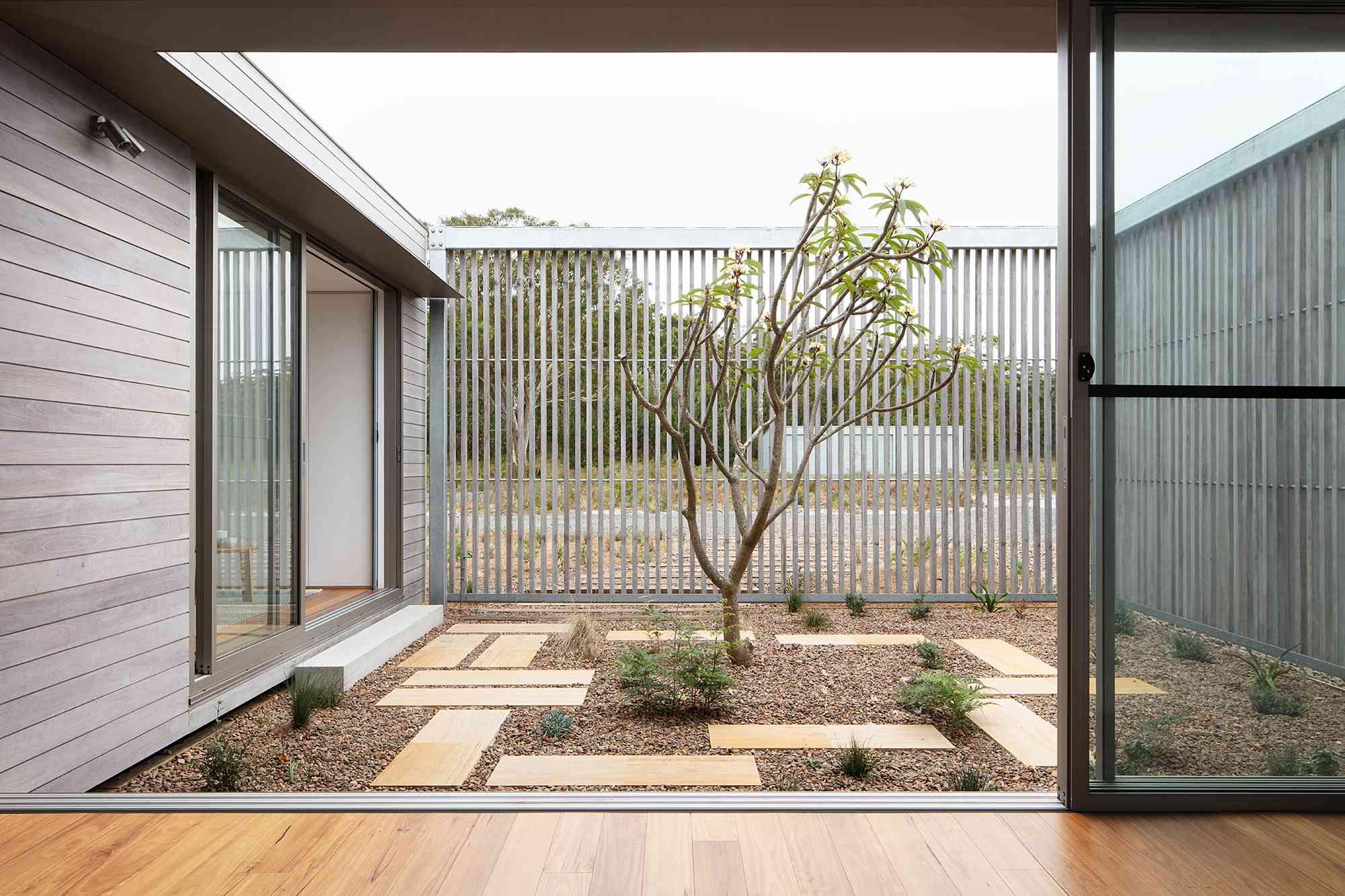 Courtyard House by CHROFI and FABPREFAB verandah
