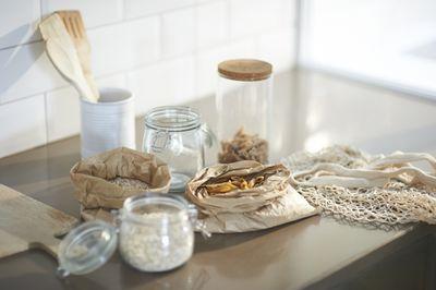 Ingredients and wooden utensils in plastic free zero waste kitchen