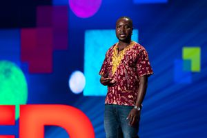 William Kamkwamba speaking on stage.