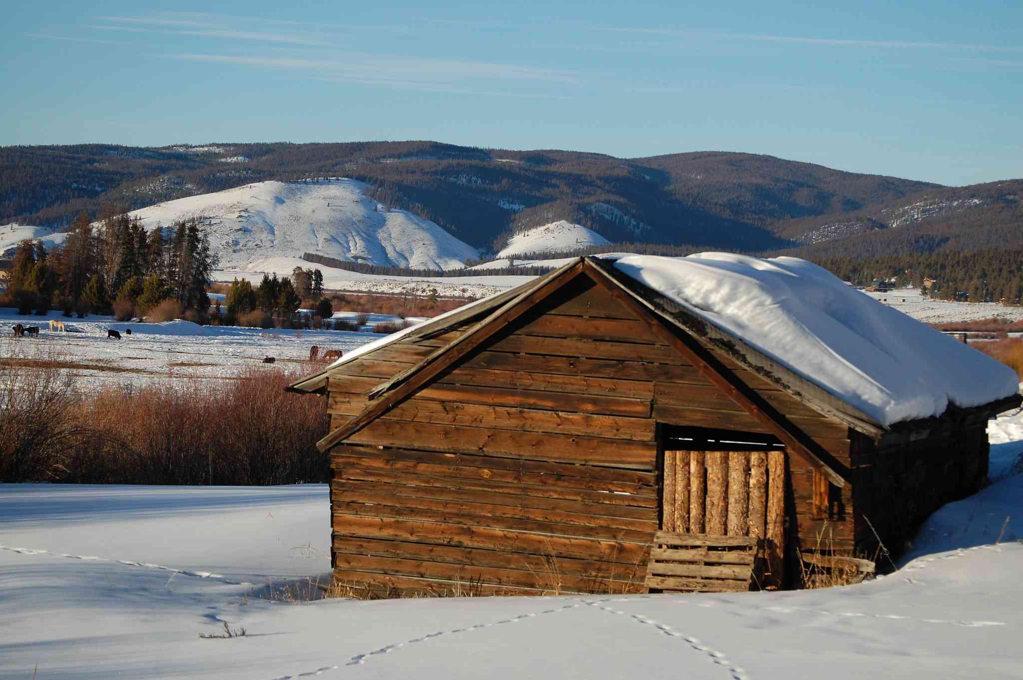Snow-covered cabin in Fraser, Colorado