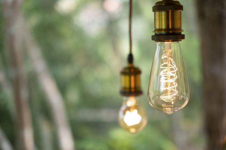 Hanging incandescent light bulbs lit up.