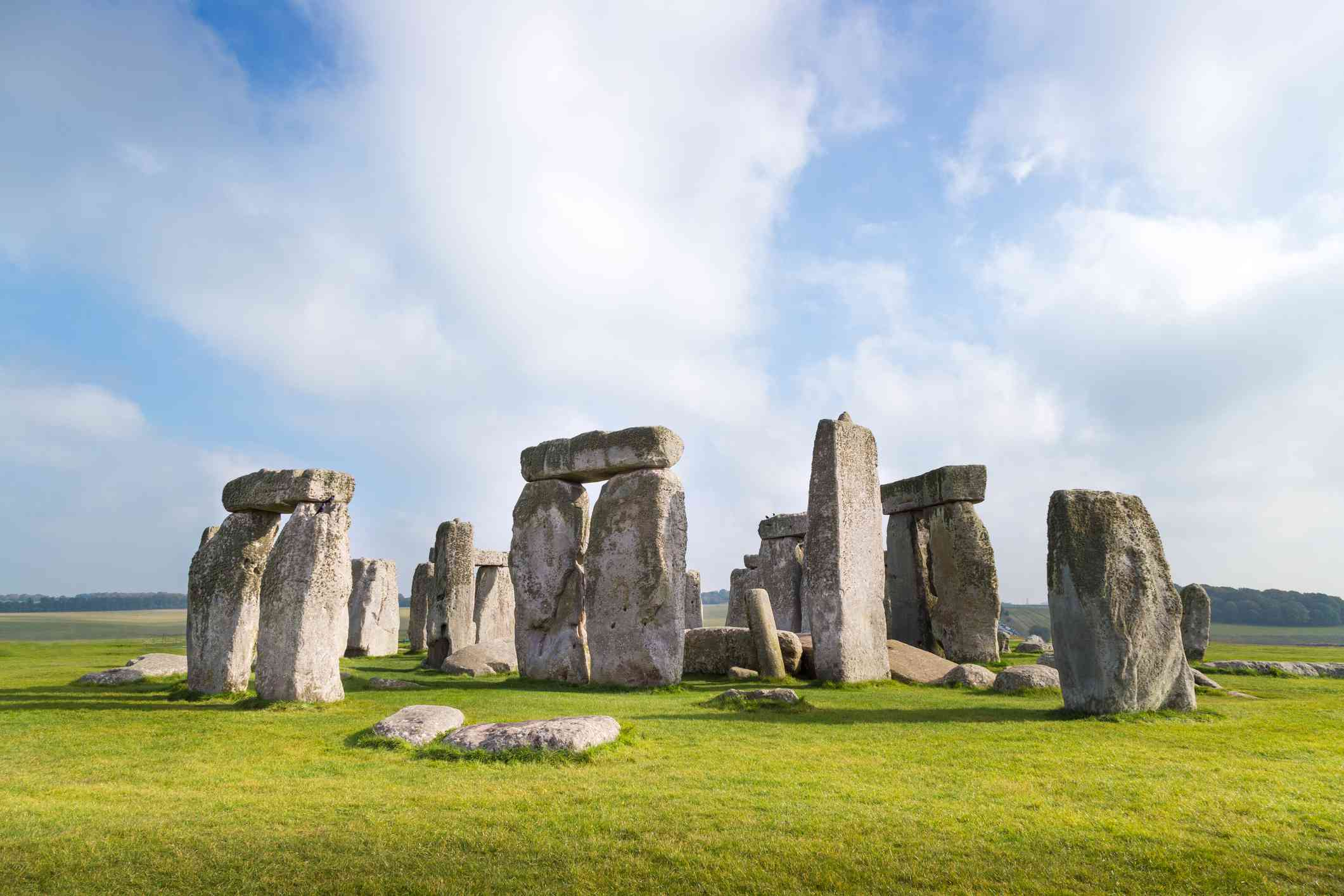 Large ancient standing stone monuments in a grassy field