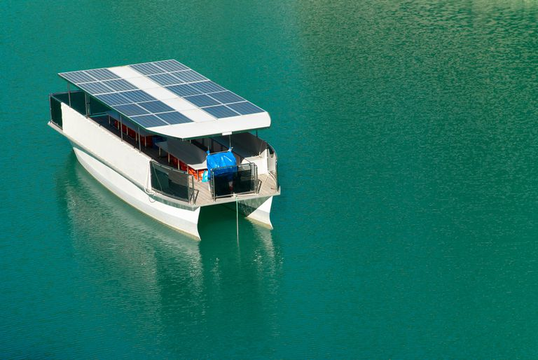 catamaran moored in the water with solar panels on the roof