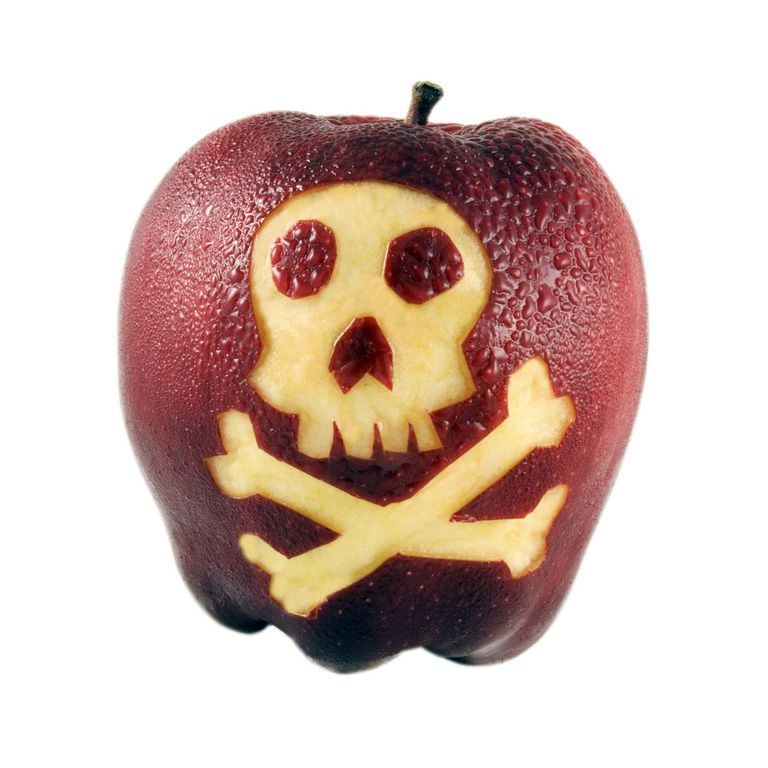 An apple with a skull carved into it