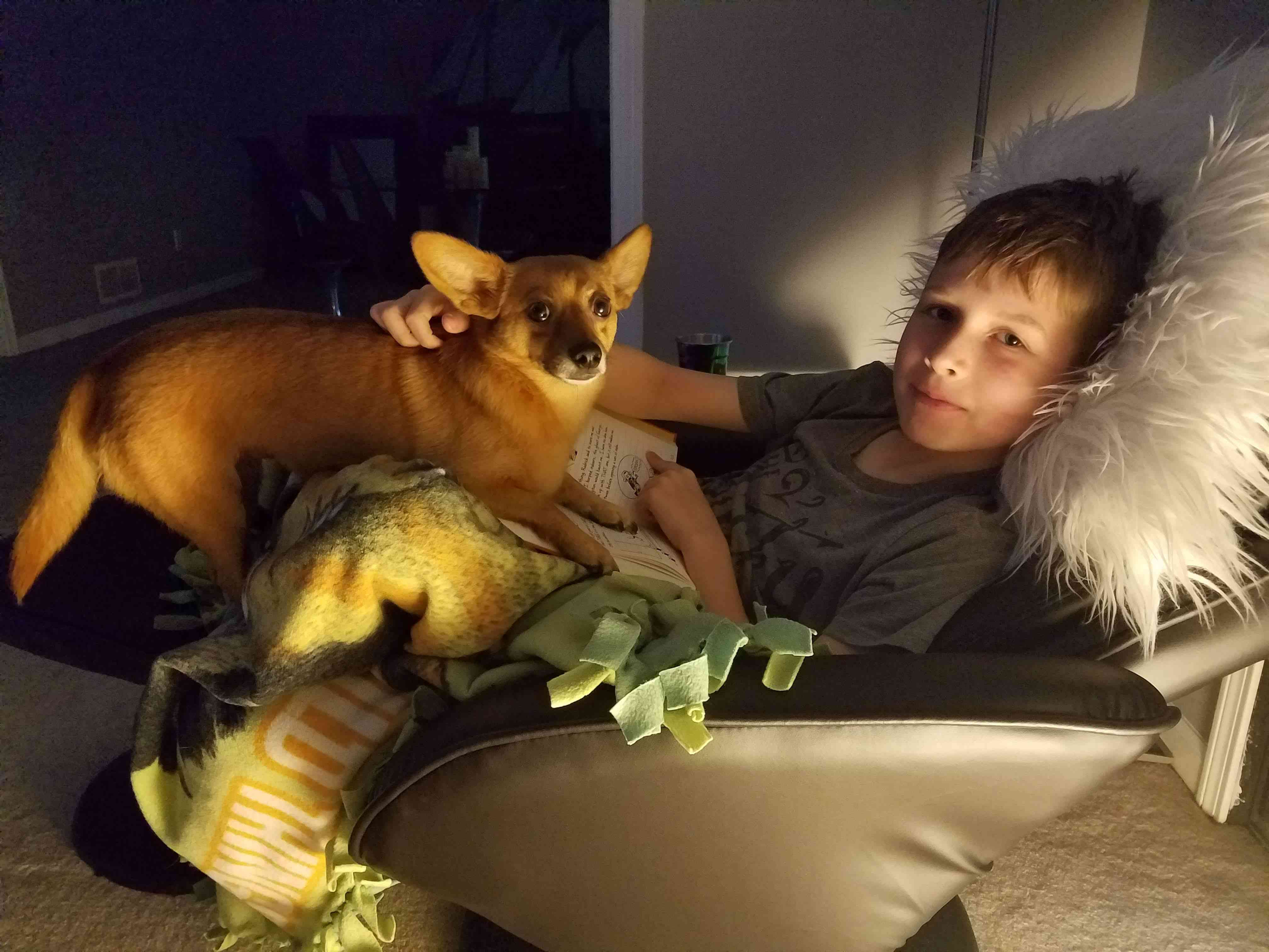 Jack with Professor Peanut, one of his family's two rescue dogs.
