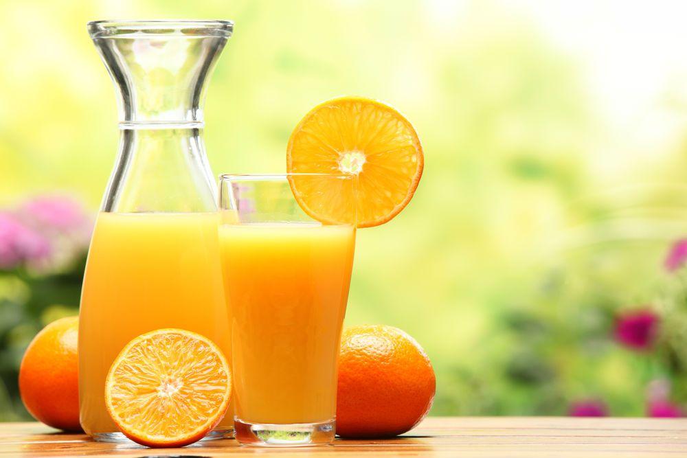carafe of orange juice and a glass of orange juice high in vitamin d