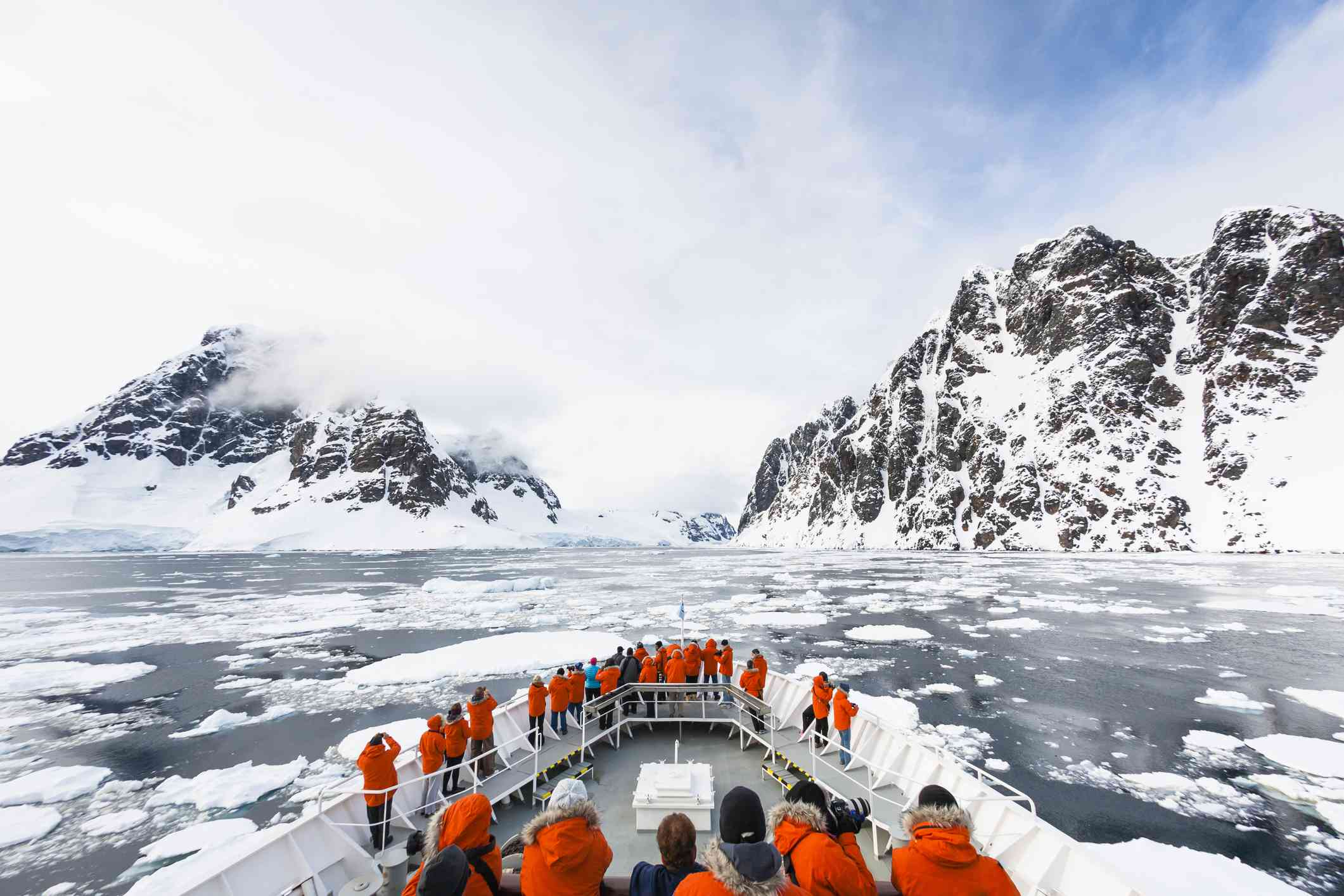 A cruise ship approaches the Lemaire Channel in Antarctica