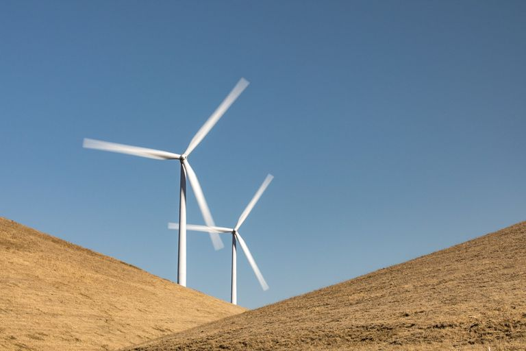 Two wind turbines in the hills