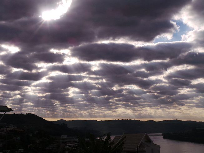 Stratocumulus stratiformis clouds over a river