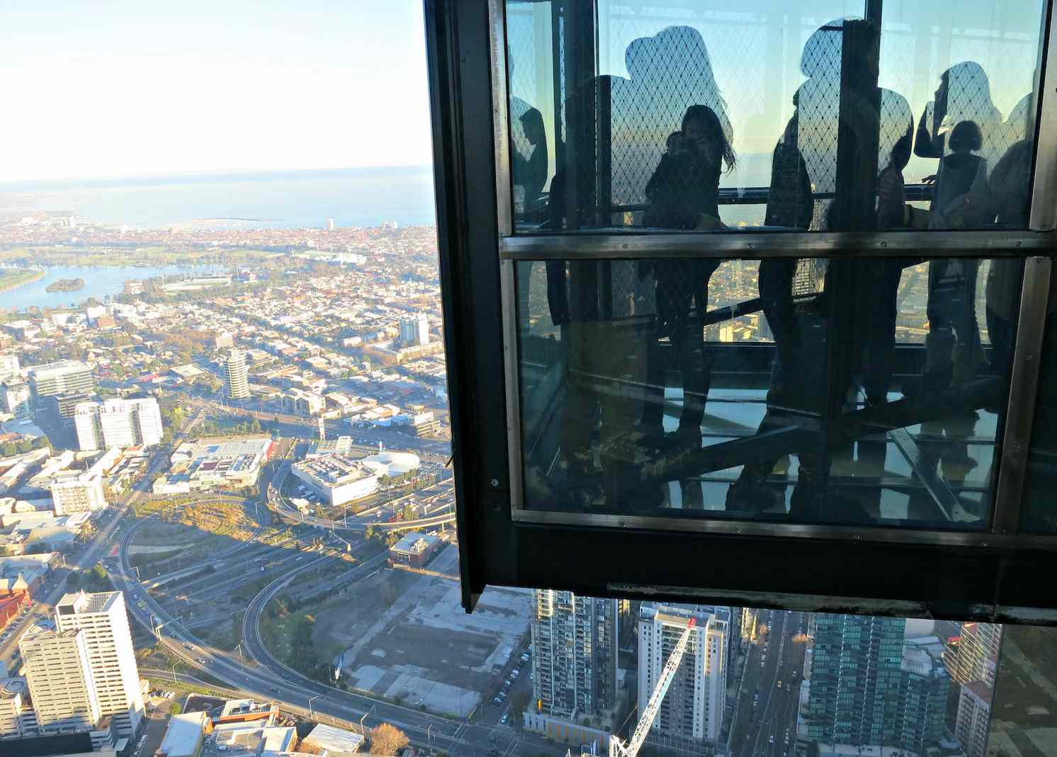Visitors to the Eureka Skydeck look out onto the Melbourne cityscape.