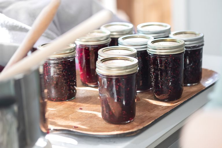 Jam being canned at home in jars.