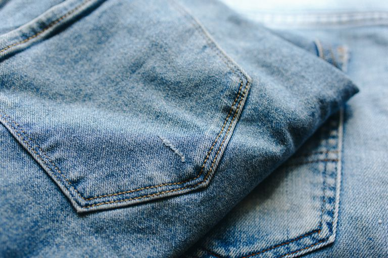 two pairs of denim jeans stacked on top of each other