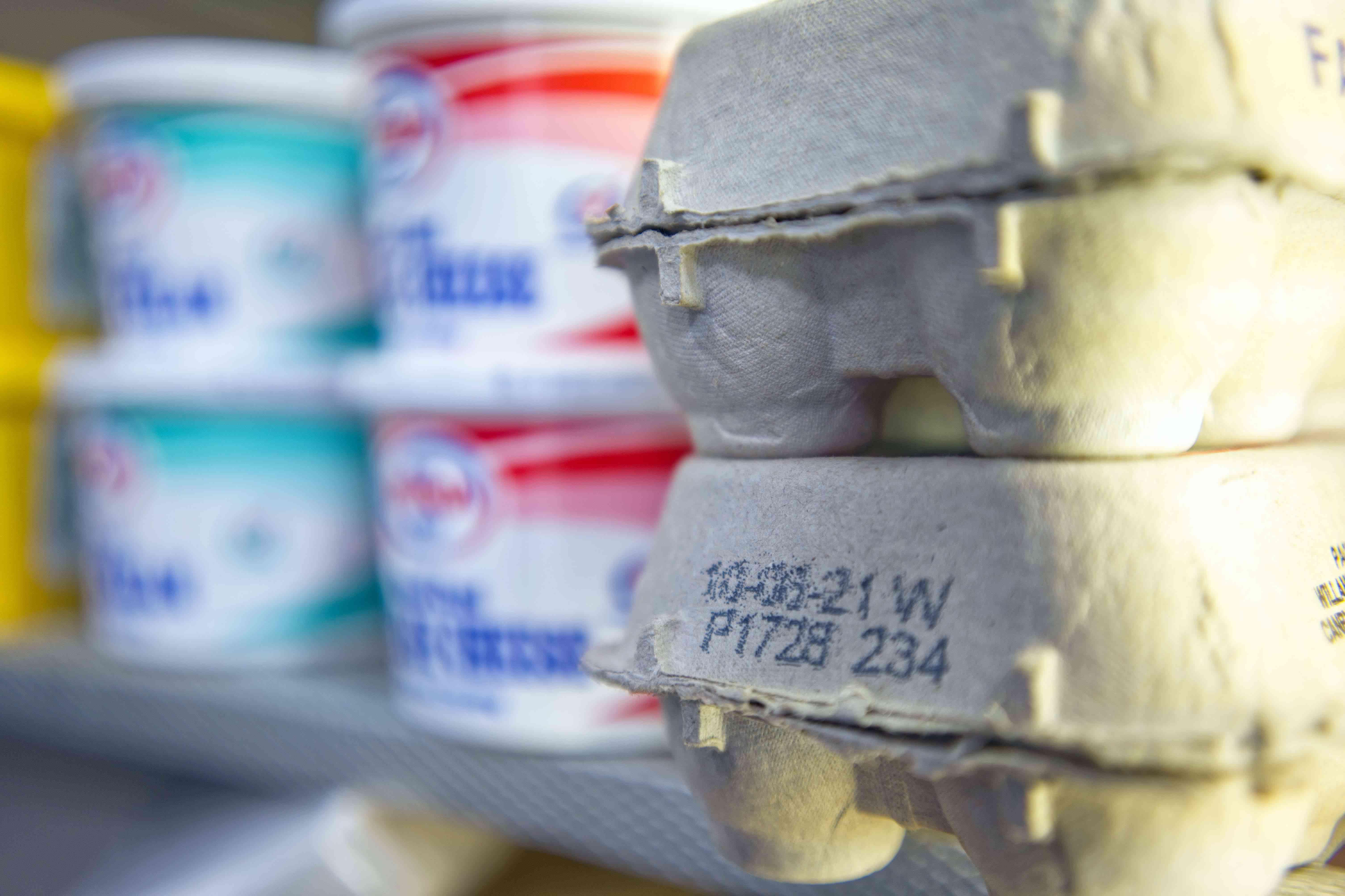 closeup of expiration date on fresh egg carton in fridge