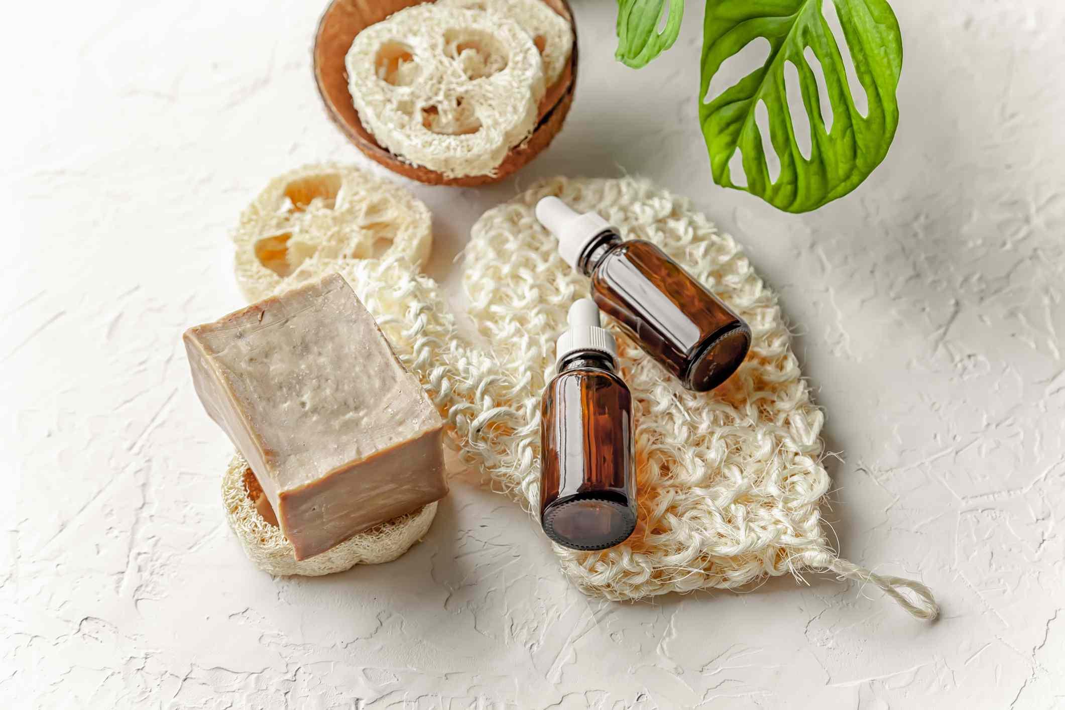 Homemade shampoo bar next to bottles of oils