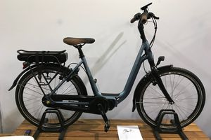An electric bike sitting on a piece of wood