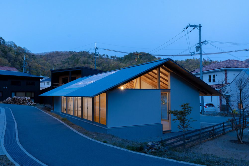 Deep eaves and light roof at night