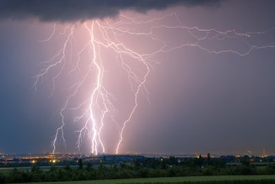 Lightning strikes over a town