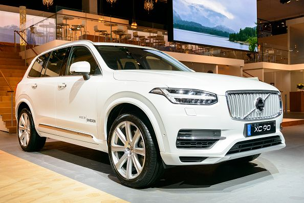 White Volvo XC90 mid-size luxury crossover SUV front view.