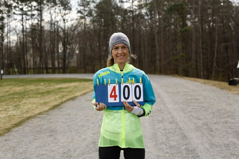Runner holding up sign that reads '400'.