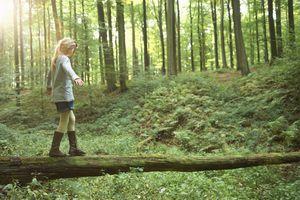 Girl walking on a tree trunk