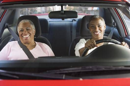 Daughter drives with mother in the passenger seat