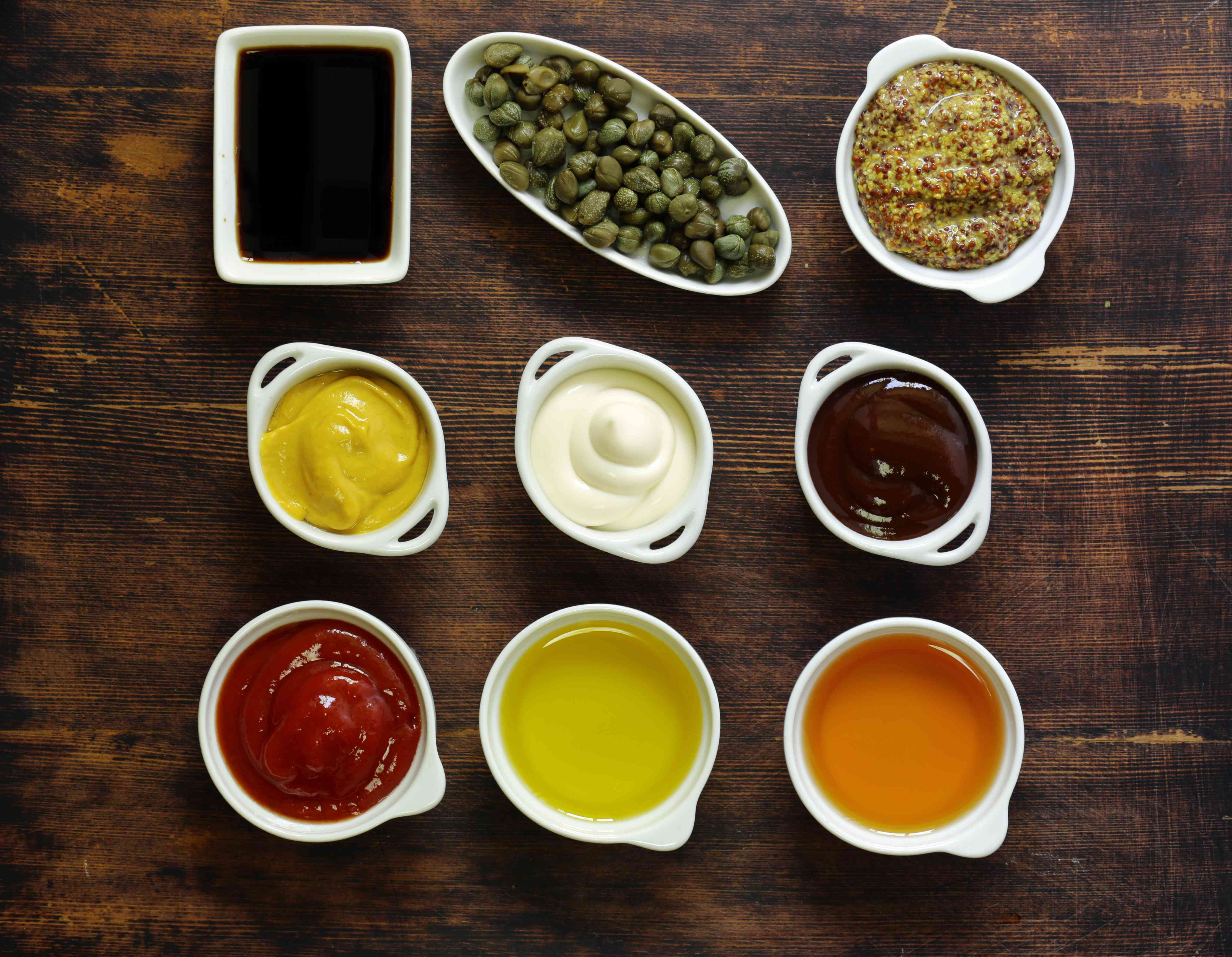 Different types of sauces and oils in bowls