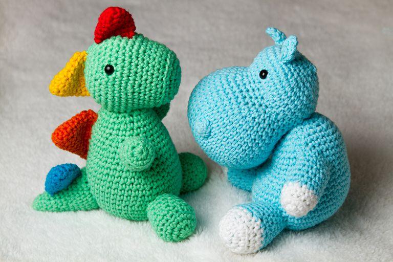 Crocheted dinosaur and hippopotamus
