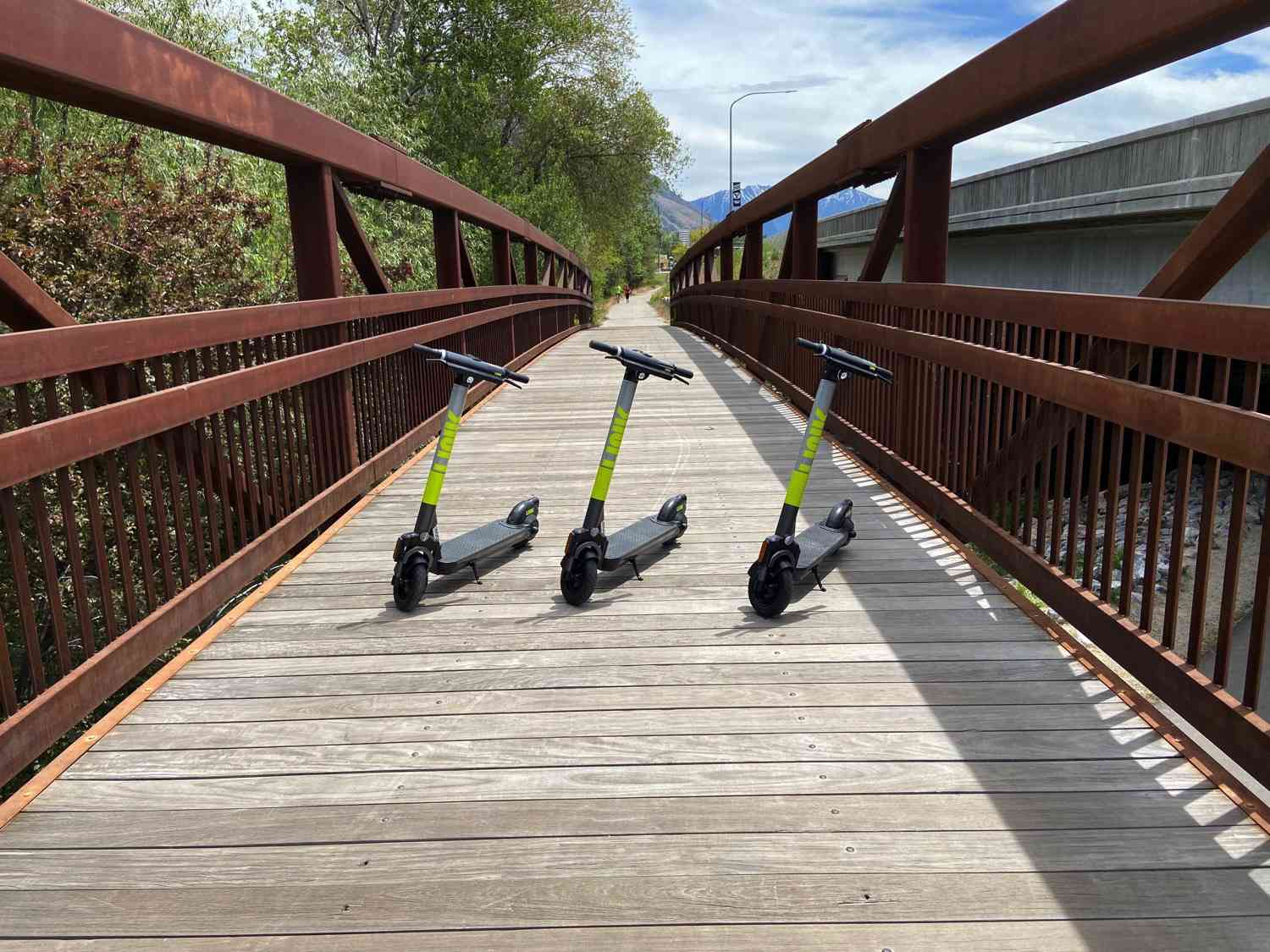 3 scooters parked in a walkway