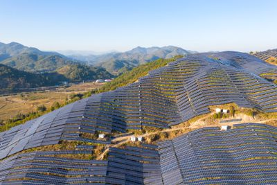 Solar panels cover a hillside in Fujian province, China.
