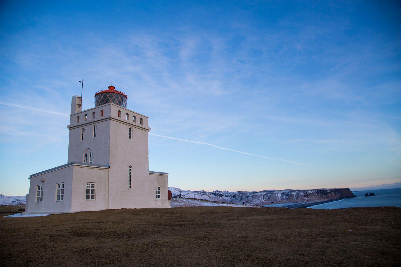 Dyrhólaey Lighthouse on the southern coast of Iceland at dusk