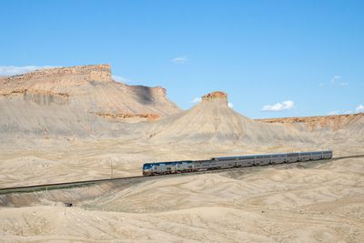 California Zephyr train in front of desert mountains in Utah