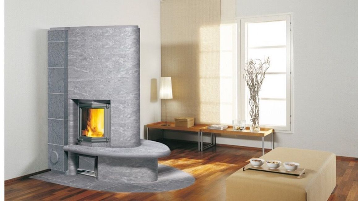 Gray stone fireplace in a beige and white room