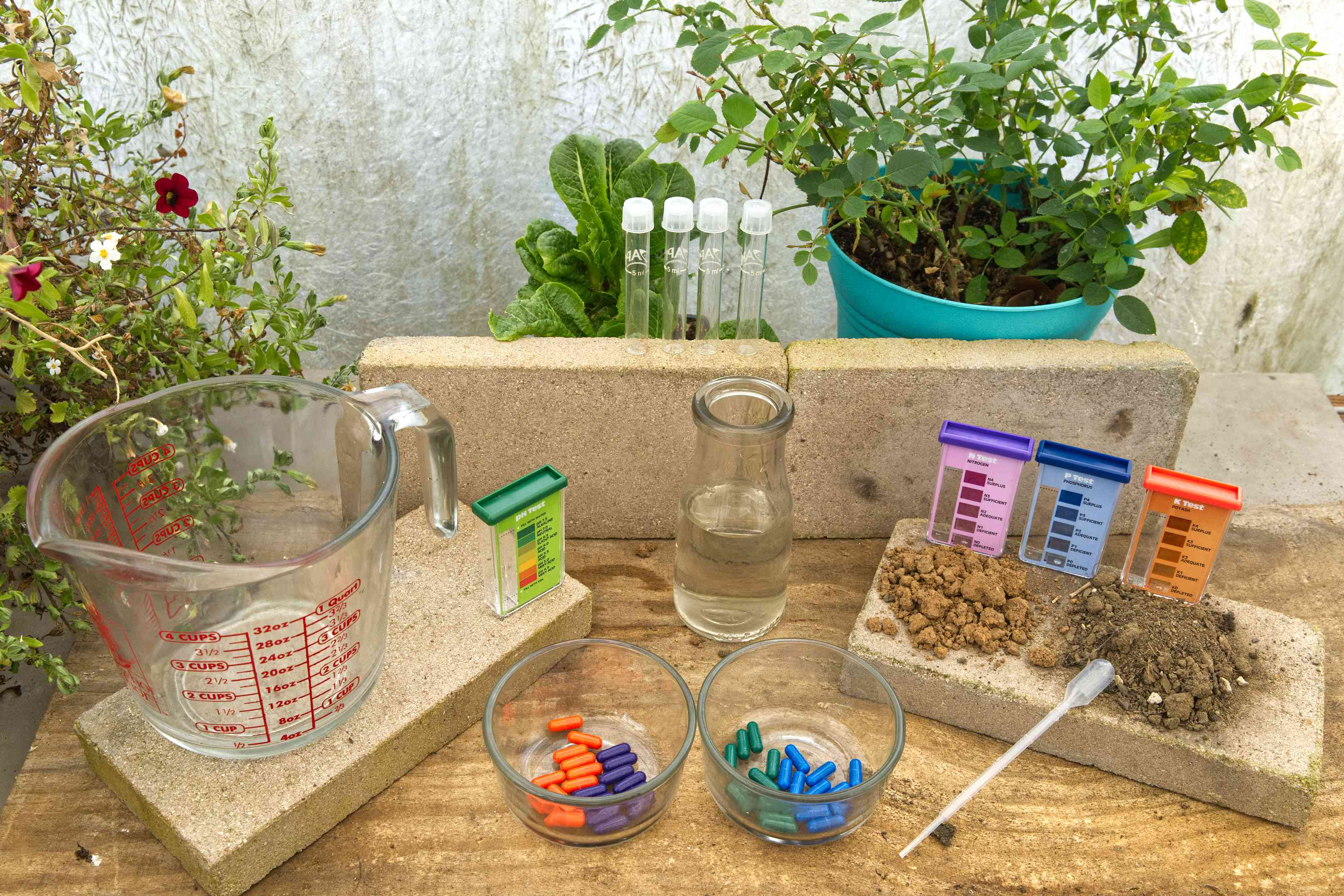 display of DIY soil kit on cement planters with various testing solutions and containers