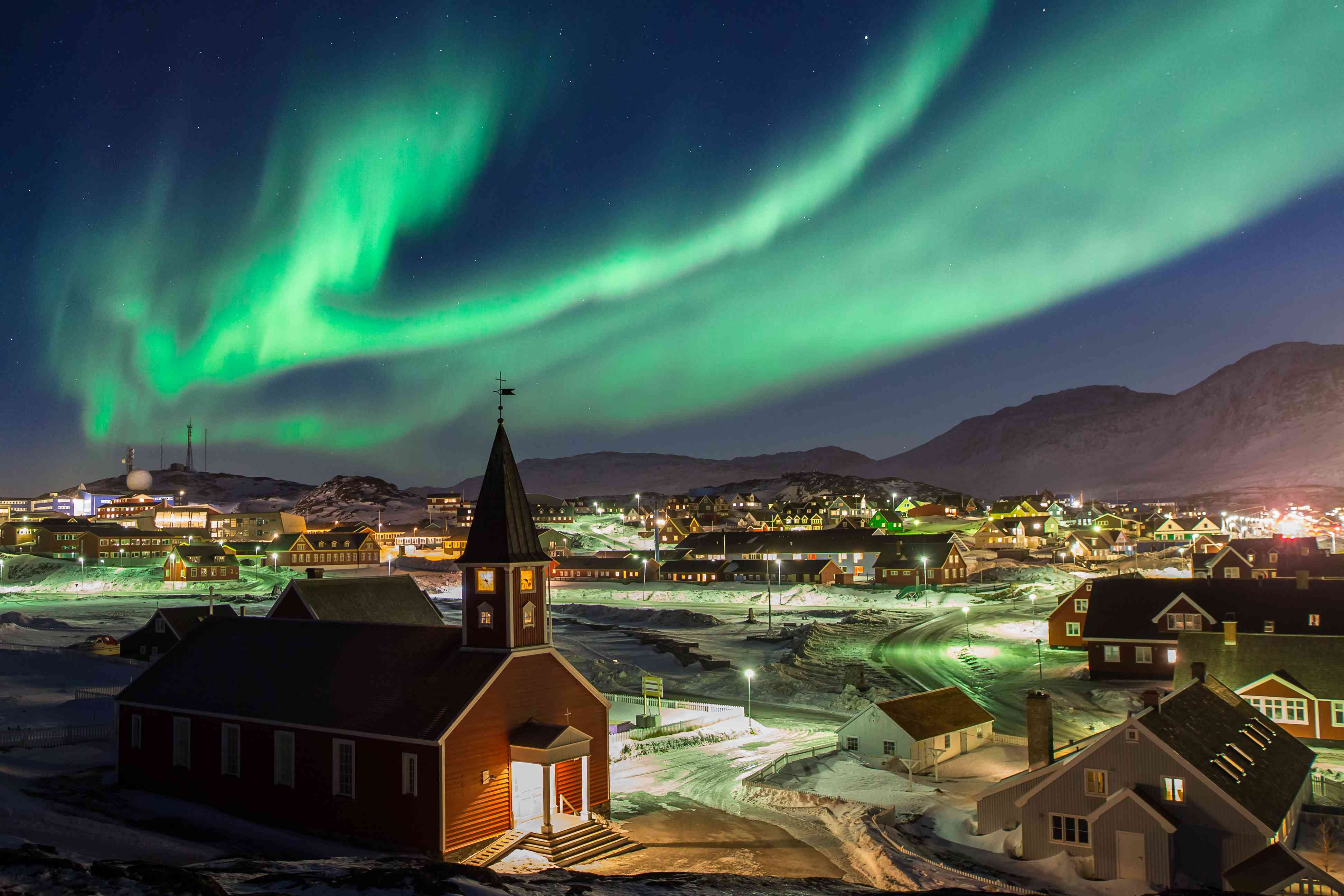 Northern lights above a church and the town of Nuuk