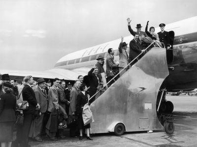Passengers board a jet in 1952