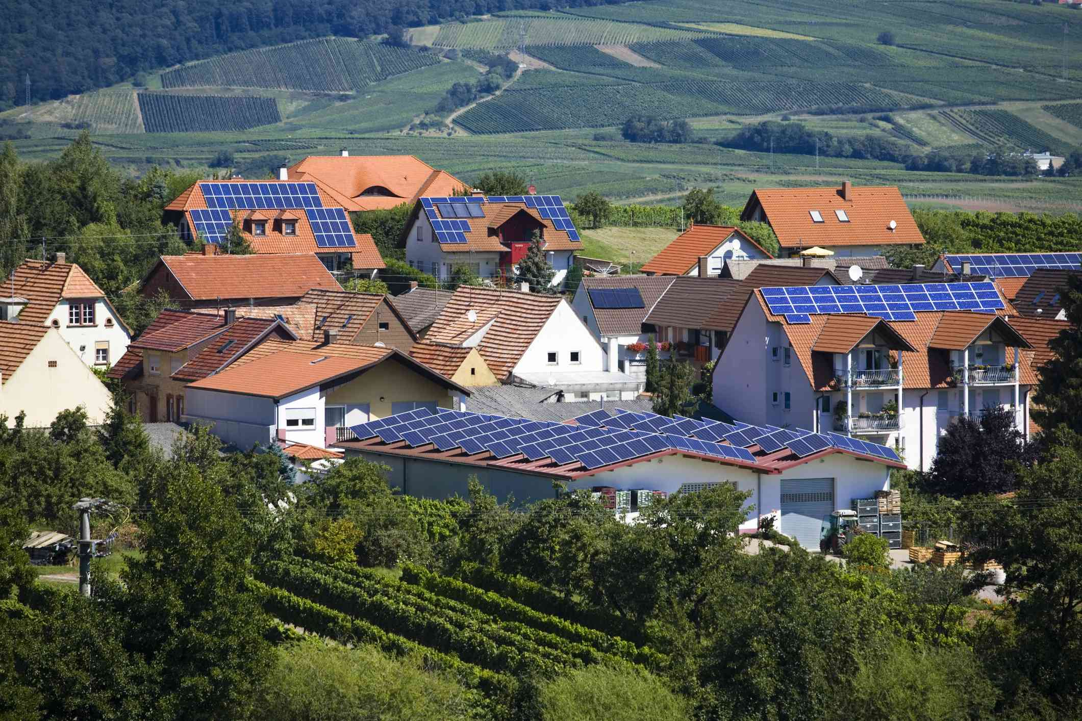 A village with homes that have solar panels.