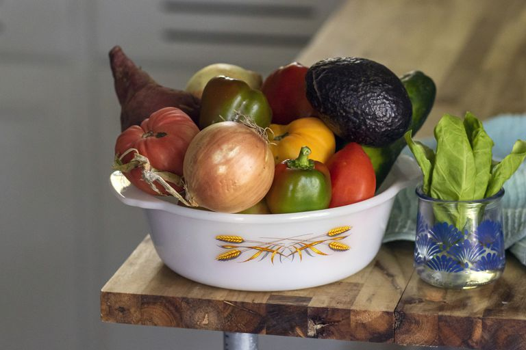 fruits and veggies in a white bowl