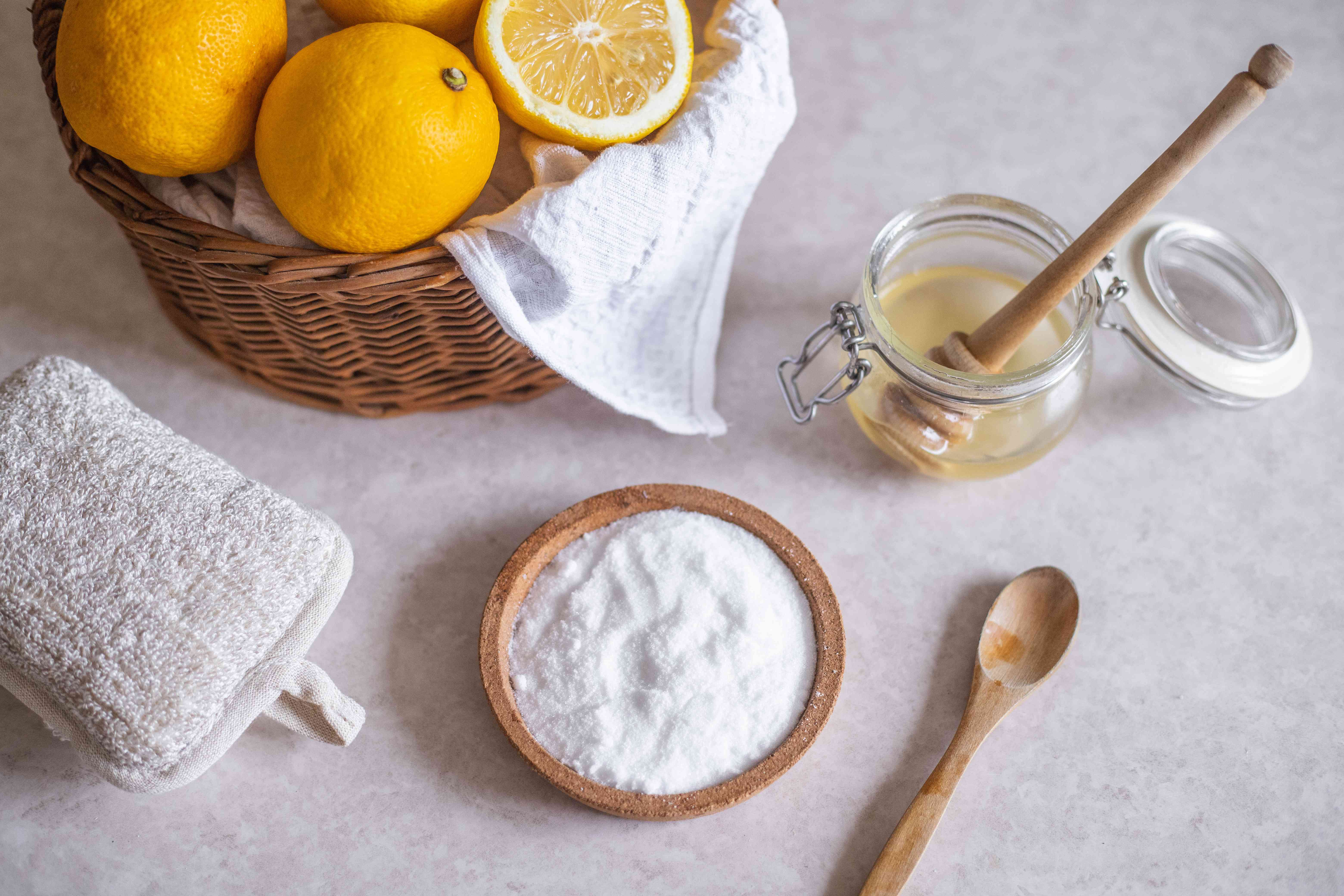sugar, honey, and lemons in a basket are ingredients for removing blackheads