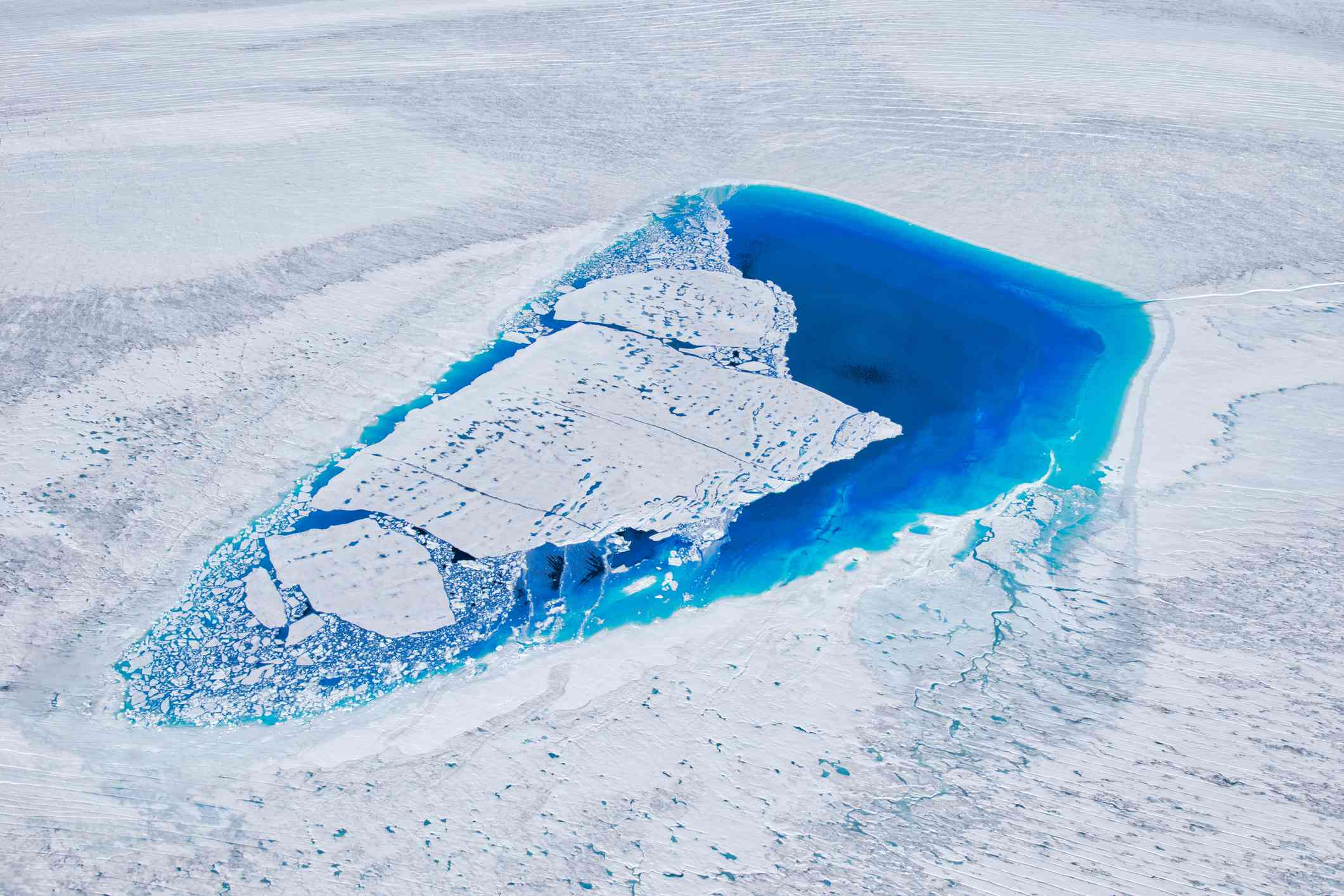 A brilliant blue lake on the Greenland Ice Sheet