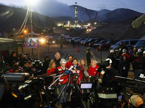 Rescuers talking to the media in Chile