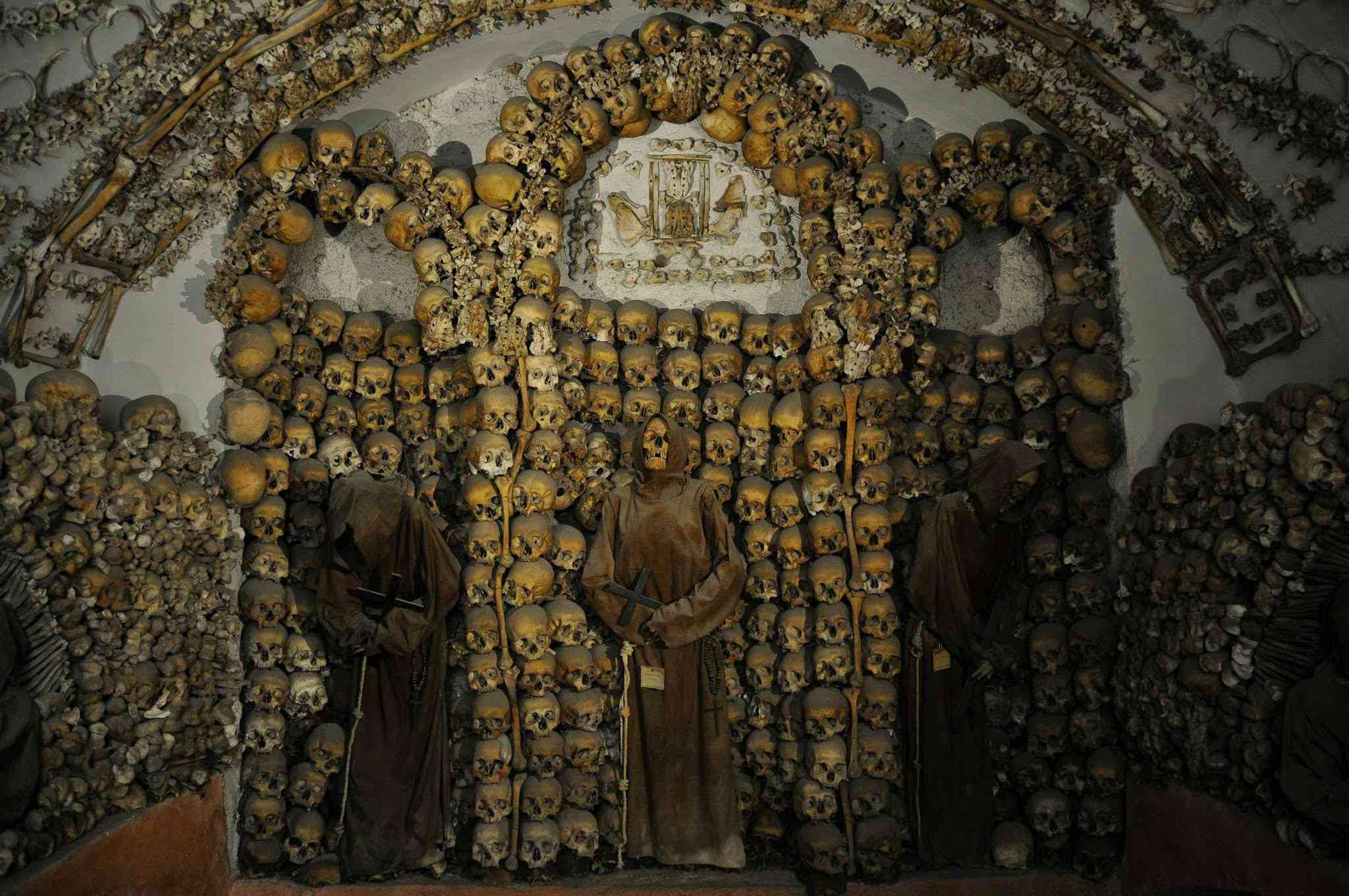 A display of skulls adorn the walls of the Capuchin Crypt in Rome